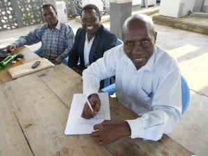 Dr Bella, Chairman of HEPOAA , signs working agreement with Busega Scotland